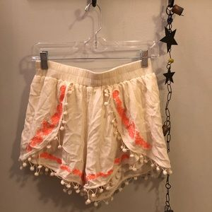 Cream pom-pom shorts with orange embroidery